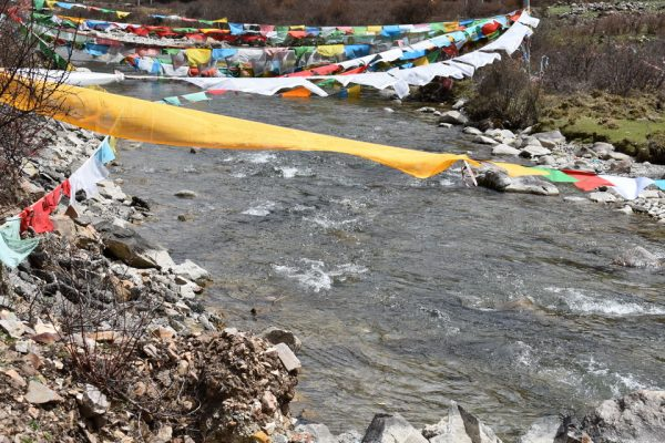 Prayer flags at a river