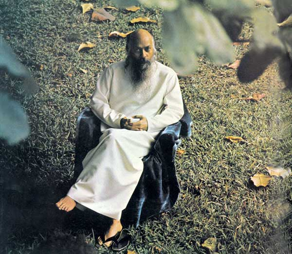 Osho under a tree