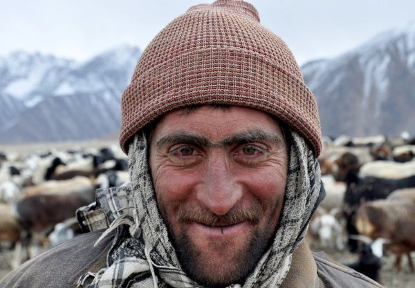 Like many locals this man makes his living as a cattle herder in the Pamir mountains. He receives a sheep at the end of the month as his salary. Men are expected to own cattle before they can ask for a woman's hand in marriage.