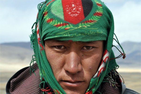 Ziauddin's bandana showed the colours of the Afghan flag. Some locals criticise the central government for failing to deliver on its promises to the region, but most of them show a strong sense of national pride.