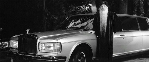 Osho standing next to Rolls Royce