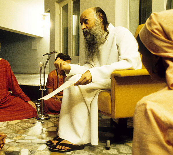 Osho giving sannyas