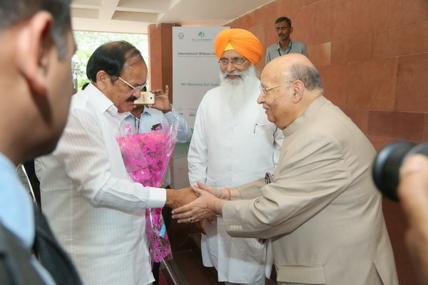 Lord Raj Loomba (right) welcomes India's Vice President Naidu (left)