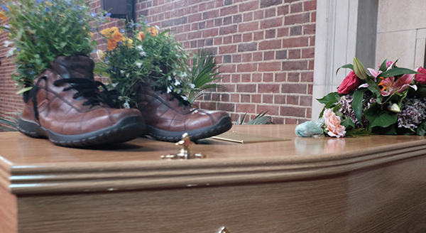 Shoes on coffin