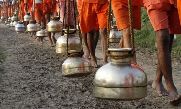 Men carrying water vessels