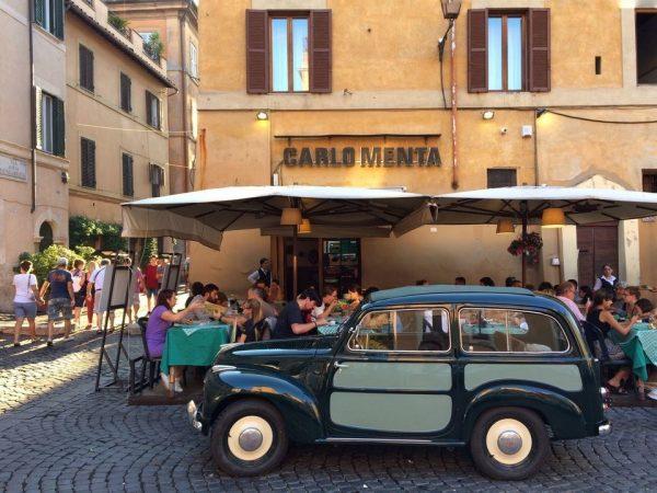 Classic car parked outside ristorante Carlo Menta, Trastevere