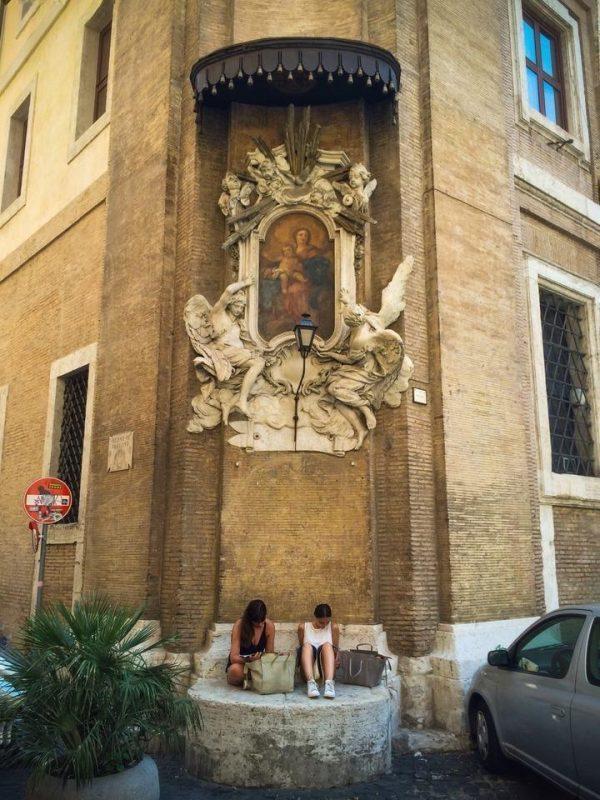 Streetcorner Madonna at Piazza dell'Orologio