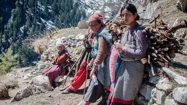 Village women carrying firewood