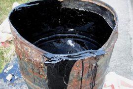 Bucket with tar