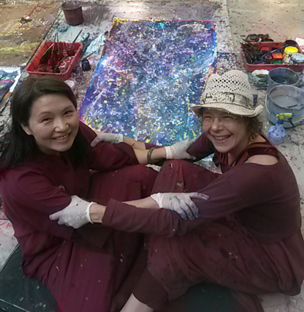 Modita and friend painting in a workshop with Meera