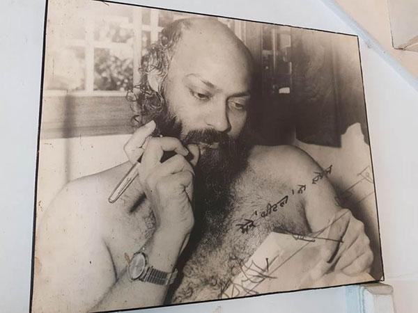 signed portrait photo of Osho