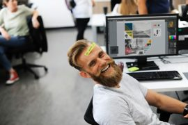 man in office laughing