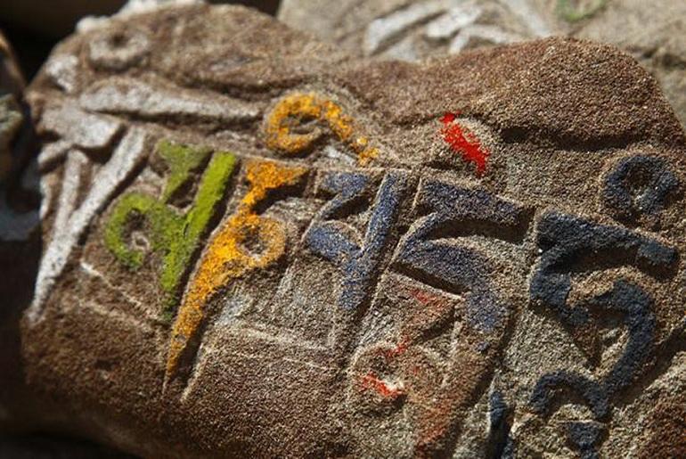 Tibetan Mantra in stone