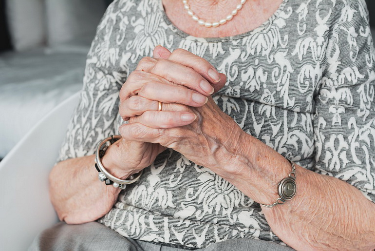 Elderly woman praying