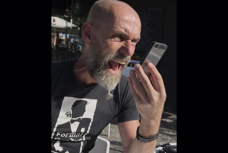 Man shouting into mobile