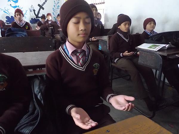 Children in Nepal meditating