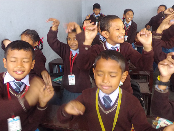 Children in Nepal meditating