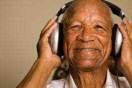 old person with headphones