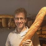 Baker with long baguette