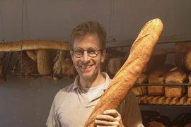 Baker with long baguette