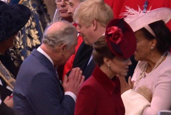 Prince Charles namasteing