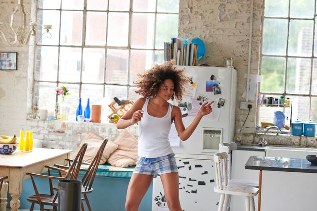 Woman dancing in kitchen