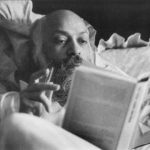 Osho reading in bed