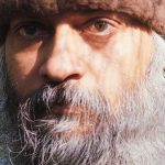 Osho with brown hat