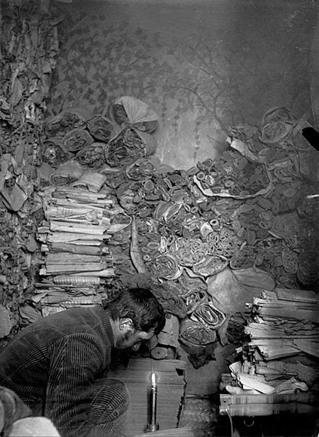 French Paul Pelliot sorting manuscripts in the Library Cave in 1908