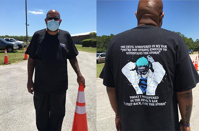 Black man wearing T-shirt with slogan