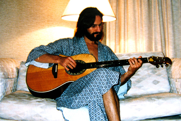 Strumming my guitar in a Singapore hotel, 2000