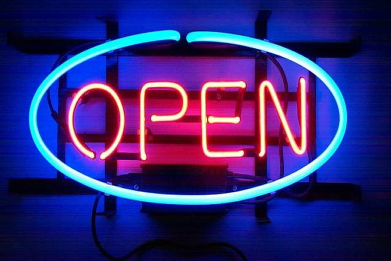 Neon light saying OPEN