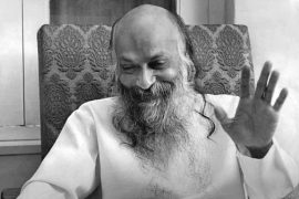 Osho darshan holding up hand