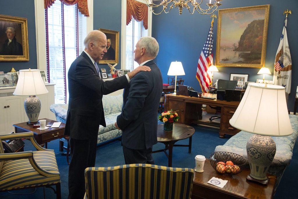 Joe Biden greets incoming vice-president Mike Pence, Nov 2016