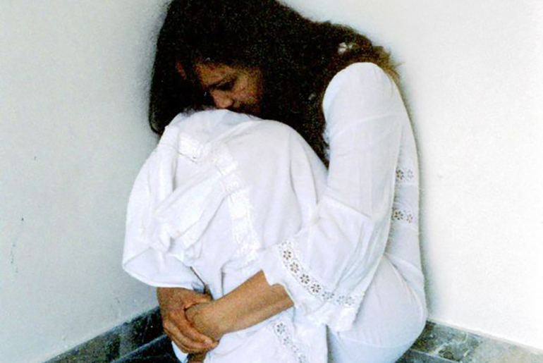 Depressed girl in corner