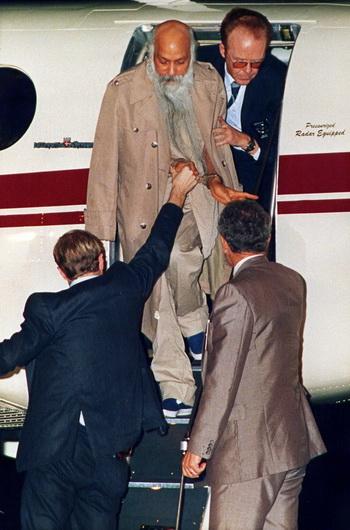 Osho disembarks prison plane