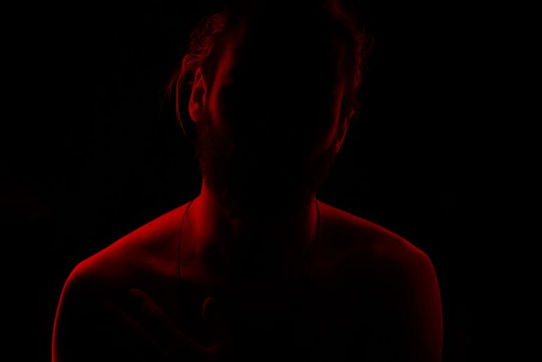 women standing in the dark