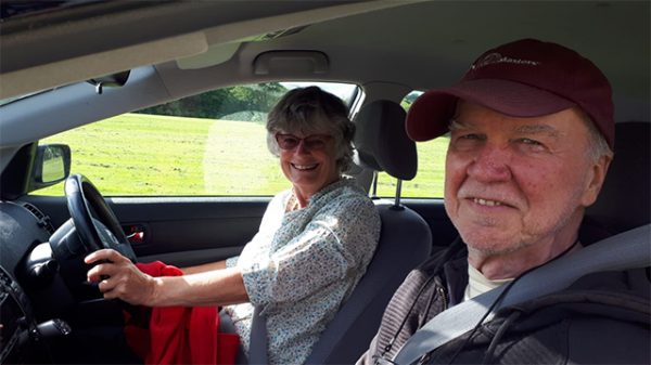 John and Mukta in car