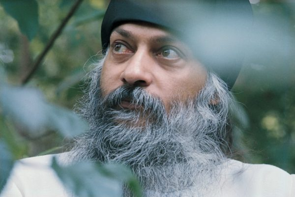 Osho with black hat