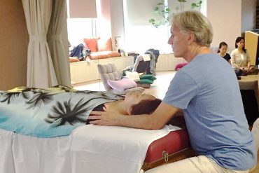 Chintan giving a craniosacral session
