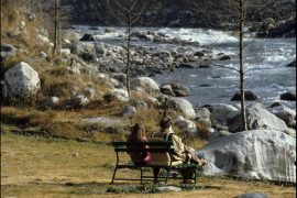 Osho and Nirvano sitting on a bench in Manali