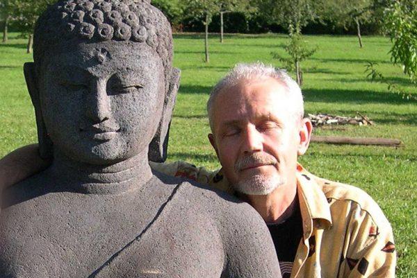 Meditator with Buddha statue