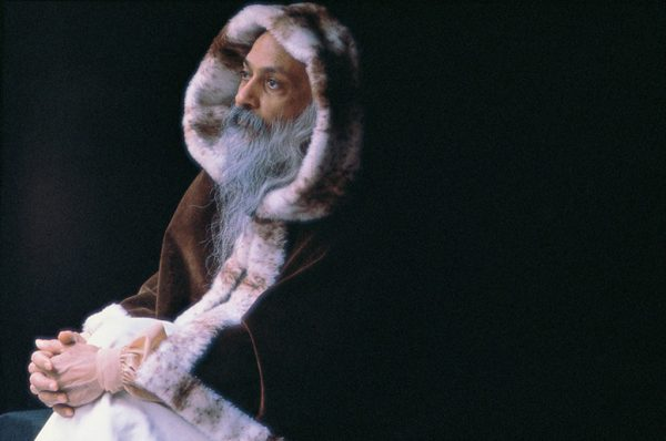 Osho with fur coat