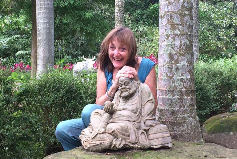 Navanita laughing with the Buddha