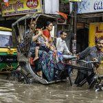 Rickshaws in high water