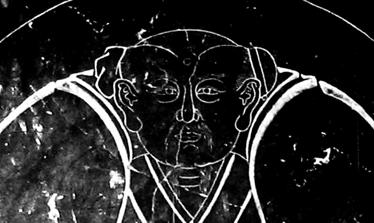 3 faces on stone stele