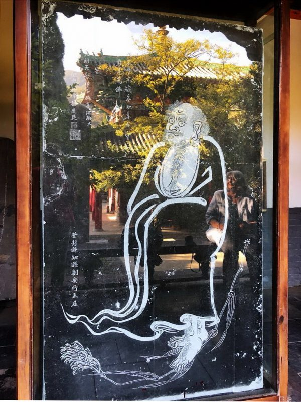 Bodhidharma's image with reflections.