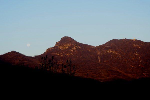 Early the next morning, full moon setting over Wuru Peak