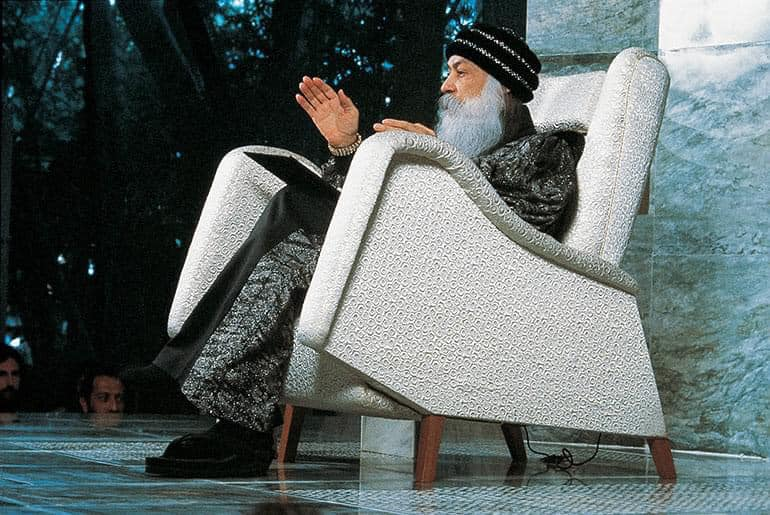 Osho sitting in chair