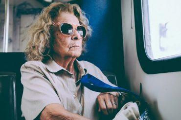 Elderly lady in bus